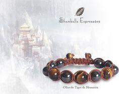 Shamballa - Olho de Tigre e Hematita As Shamballas Expressões convidam você para o despertar da força criadora que habita seu ser.