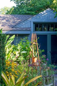 A simple structure adorned with a vine or a potted plant, such as this obelisk, provides an impromptu vertical element that's easily moved, season to season. | Photo: Rob Cardillo | thisoldhouse.com