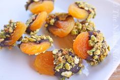 Dried apricots dipped in chocolate and sprinkles with chopped nuts, grated coconut of sugar sprinkles.