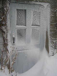 Snow covered door after winter storm