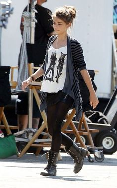 Picture tank top, stripey cardie, black tights, a short skirt, and black lace boots. (This outfit was not actually worn on modern family, I don't think but still I like it.)