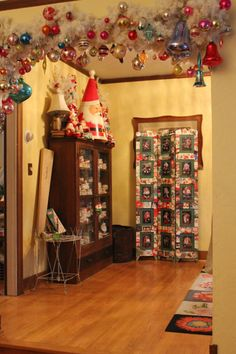Heading into the dining room. I never tire of the garland hanging between the two rooms. I love...