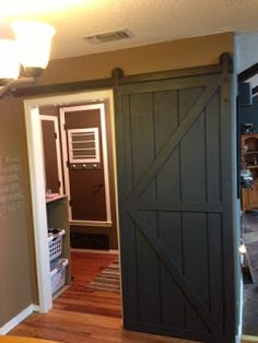 Wilker Do's: DIY Sliding Barn Door. This is the simplest set of directions I have found.