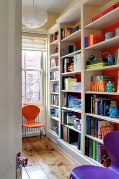 home office with built in bookcases with orange painted backs, pantone celosia orange april 2014 color of the month