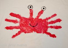Crab handprint t-shirt...would be cute on paper too, with sand sprinkled underneath!