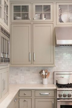 My favorite kitchen cabinet idea Carrara marble subway tile kitchen backsplash with taupe cabinets.