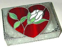 Thisred heart& rose jewelry box is artisticallyhandcrafted from hand cut, high quality American made stained glass.The jewelry boxis then decoratively hand-soldered in the Tiffany copper foil method.You will find thisstained glass heart jewelry box to be a perfect giftfor yourself or for a friend. Nice Valentine's Day gift or Mother's Day gift.  - www.AccentOnGlass.com