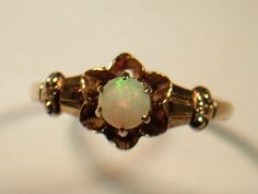 Art Deco Ladies Opal Ring set in a flower setting 6 prong set Rose Gold Beautiful Ring Engagement Ring. $164.99, via Etsy.