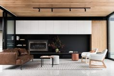 Lounge room inspiration - black, white timber and concrete