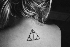 """""""A circle inside a triangle tattoo.""""  -____- ITS CALLED THE DEALTHY HALLOWS!!!!!!"""