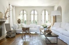 Soft White Living Room with Arch Windows