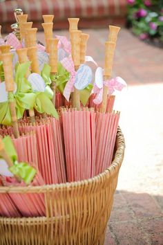 pink and green wedding parasols / umbrellas