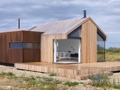 redhousecanada: worclip: Pobble House (2013) by Guy Hollaway Architects Photographed by Charles Hosea Location: Ashford, Kent, England Owing to the site's significance, local planning policy dictates that any new building must replace an existing one and is to be of similar scale and proportion to that of the original. The design response from GHA to the clent's brief was to create an architecture that understands 'place'. To this end a material palette was chosen that would enhance with…