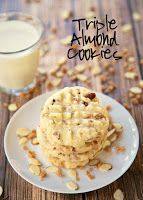 Triple Almond Cookies Recipe - cookies packed with tons of great almond flavor - almond extract, chopped almonds and almond toffee bits! We ate WAY too many of these cookies. Makes a ton. Great for a potluck!