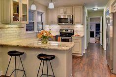 Traditional Kitchen with Raised panel, High ceiling, Breakfast bar, flush light, Undermount sink, Flush, Pendant light