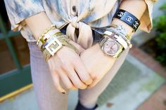 Juanita Sperry of The Shop Public Relations has one heck of an arm party. Hermes, Fendi, Chanel — the gang's all here!  (via refinery29)