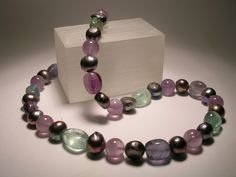 Necklace with gray freshwater pearls, amethyst and fluorite
