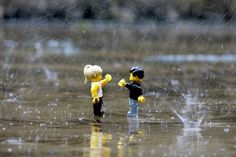 they look like they might be playing rock paper scissors...silly lego people, its raining!