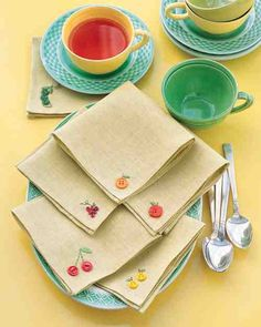 It takes only a few oddball buttons and embroidery floss to transform plain napkins into a harvest of whimsical linens. For Sue?