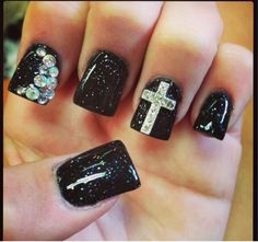 Black glitter nail design with rhinestones and cross