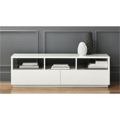 "chill white media console | CB2  Here is a simple, low media stand. Only 19.25"" high (so shouldn't interfere with screen?).   Like the idea of white since the sofa is dark brown and AV things are black. Wish this was on legs, but still think it's pretty nice.  I get 15% discount."