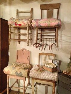 Vintage Wooden Chairs Hanging on the Wall to Display Objects Like Vintage Quilts & Clothing