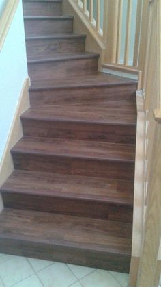 These stairs are so beautiful, great job Harry. I cant believe its not hardwood. Its actually Luxury Vinyl Plank. So Awesome. Waterproof, antimicrobial, anti fungal, with sound dampening. You can drive a forklift on it, and they look remarkably real. starting at 3.50 a sq ft installed. call 707-450-5056 for a free estimate