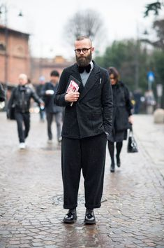 Street Style From Pitti Uomo - NYTimes.com    Angelo Flaccavento wears a San Giovino 6 suit with Moscot glasses and Church's shoes.