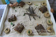 Dinosaur land exploration with caves or nests in the sand table - Teach Preschool ≈≈