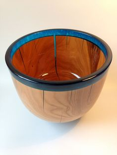 This is a beautiful 100% Unique hand turned Cherry wood bowl with a Blue and Clear resin rim, mounted on a solid resin foot with matching colours. The