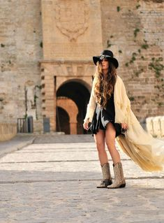 Snake skin boots and black dress. Summer boho outfit by Madame de Rosa