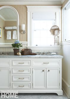 Love the trim around the windows in this bathroom via NE Home Mag