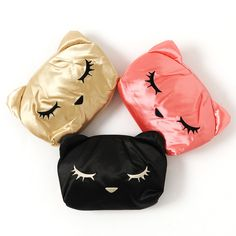Go out in style with this **satin pouch** designed based on **Pooh-chan!** Shaped like the sleepy cat's face, every beautiful detail was included, all the way down to her ears! These pouches feature a **zippered closure** for all of your essentials on the go and are available in **black, pink,** and **gold versions,** each sure to add a stylish touch to your favorite looks. #jfashion #kawaii
