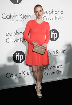 Jessica Chastain looking fabulously fresh in orange at Calvin Klein Collection's 'Women In Film' party