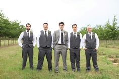 Grey tuxes for the groom and groomsmen.  Photo by Aaron Snow Photography. www.wedsociety.com  #wedding #grooms