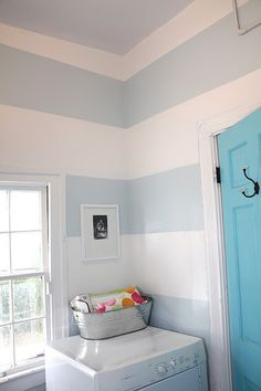 "The wall stripes are Benjamin Moore's - ""Mountain Peak White"", ""Ocean Air""  and the Doors are ""Fairy Tale Blue"""