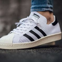Adidas Originals Superstar 80s Primeknit  The adidas Originals Superstar 80s Primeknit see's the German sportswear giants refresh their '80s classic with some contemporary tech. Whilst maintaining its iconic shell toe and contrast three stripes, this iteration also sports Primeknit technology across the upper making for a flexible, breathable and lightweight build. Finished with tongue branding, a soft leather lining and a durable rubber cupsole underfoot
