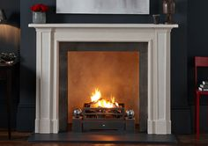 The selection of modern mantels from Chesneys is worth exploring. Some are limestone...I like the idea of mixing that in.