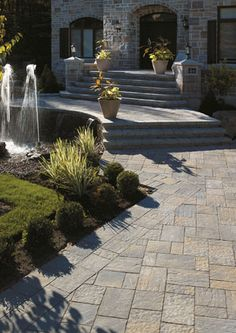 Create a stylish driveway with stone pavers from Merkley Supply. Product: Permacon Stone Pavers.