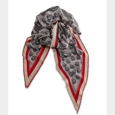 """Alexander McQueen Border Triangle Skull Scarf Alexander McQueen Ribbon-Border Triangular Skull Scarf, Gray/Red.  This is a unisex scarf, new without tags. The main tag is falling off on one side, great condition otherwise.   Alexander McQueen scarf presents a fluid reinterpretation of the collection's signature skulls, in lightweight weave that pairs well with tees, sweaters, and outerwear. A contrast border adds a bold pop of color.   * Contrast border * 89"""" X 59"""" X 59"""" *Fringed edges 70…"""