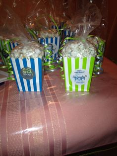Boy baby shower favors.  I made them!  Popcorn boxes and stickers from ebay.  Actual popcorn is white chocolate covered!  One bag of planters or any brand white pre-popped and one bag of white chocolate disks from Michaels.  Just melt chocolate in microwave and fold in popcorn lil by lil