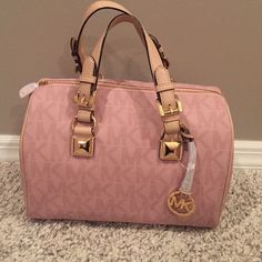 """Michael Kors Light Pink Grayson NWT MK Light Pink Grayson Gold tone hardware  Gold MK circle medallion Top zip closure Double leather handles with 7"""" drop Interior 1 zip pocket and 4 slip pockets Gorgeous Light Pink PVC Signature.. Due to the material it it super easy to cleanNO TRADES Please feel free to ask any questions Michael Kors Bags Satchels"""