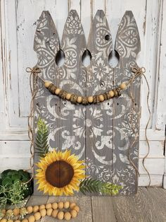"""24"""" Tall x 13.75"""" wide Are you looking for a unique, Fall decoration or a personal gift for the holidays? The handmade wooden bead and wood slice garland accents the reclaimed picket fence. The modern, free form stencil design gives this painting an interesting appearance. The sunflower and ferns are hand painted. Moroccan Stencil, Love Is Free, Stencil Designs, Wood Slices, Thanksgiving Decorations, Handmade Wooden, Wooden Beads, Fall Decor, Ferns"""