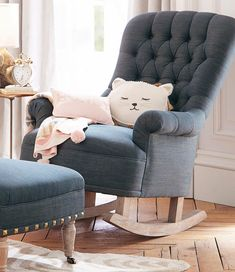 Can we talk about this chair for a minute? ✨ Part of our @emilyandmeritt collection, the Radcliffe Rocker + Ottoman was inspired by 1900s Edwardian armchairs, but we gave it a 2016 spin with denim and studs. A fashionable spot to bond with baby! Shop the look by clicking the link in our bio and tapping this photo. #eandmxpbk #shoplinkinbio