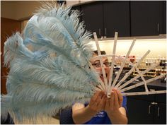 Making large feather fans, never know when we will next do a showgirl dance