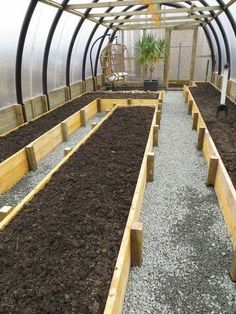 Polytunnel greenhouse raised beds