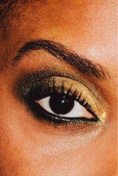 Dramatic gold and charcoal smokey eye makeup