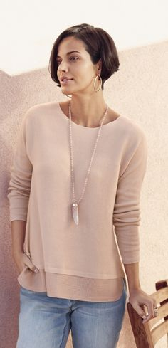 The perforated hem on this sweater + this pink pearlized horn pendant = A chic of-the-moment look.