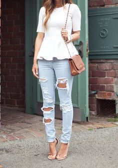 White, ripped jeans, and brown bag.