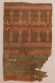 Textile Fragment from the Tomb of Don Felipe Object Name: Fragment Date: second half 13th century Geography: Spain, Palencia Culture: Islamic Medium: Silk, linen, metal wrapped thread; taqueté Accession Number: 46.156.8